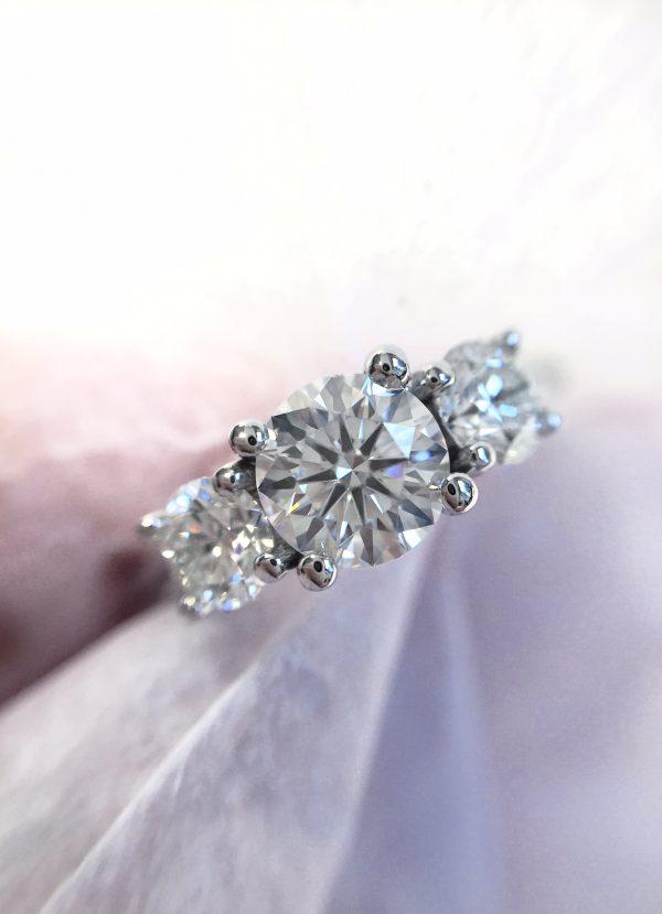 round diamond trilogy engagement ring