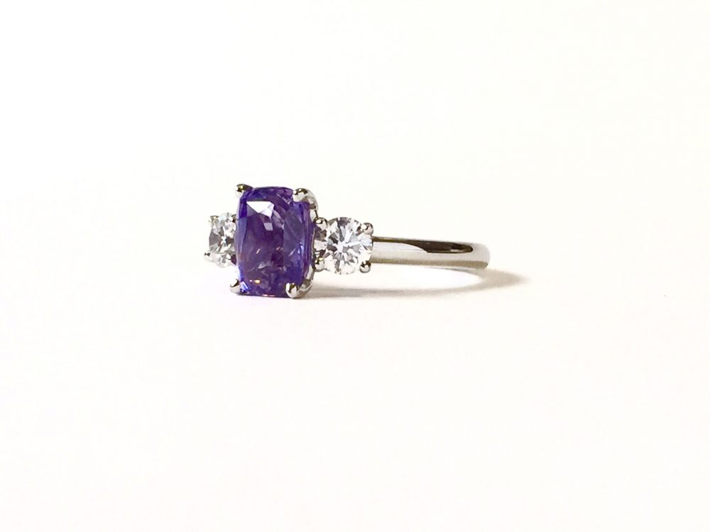 purple sapphire and diamond trilogy engagement ring