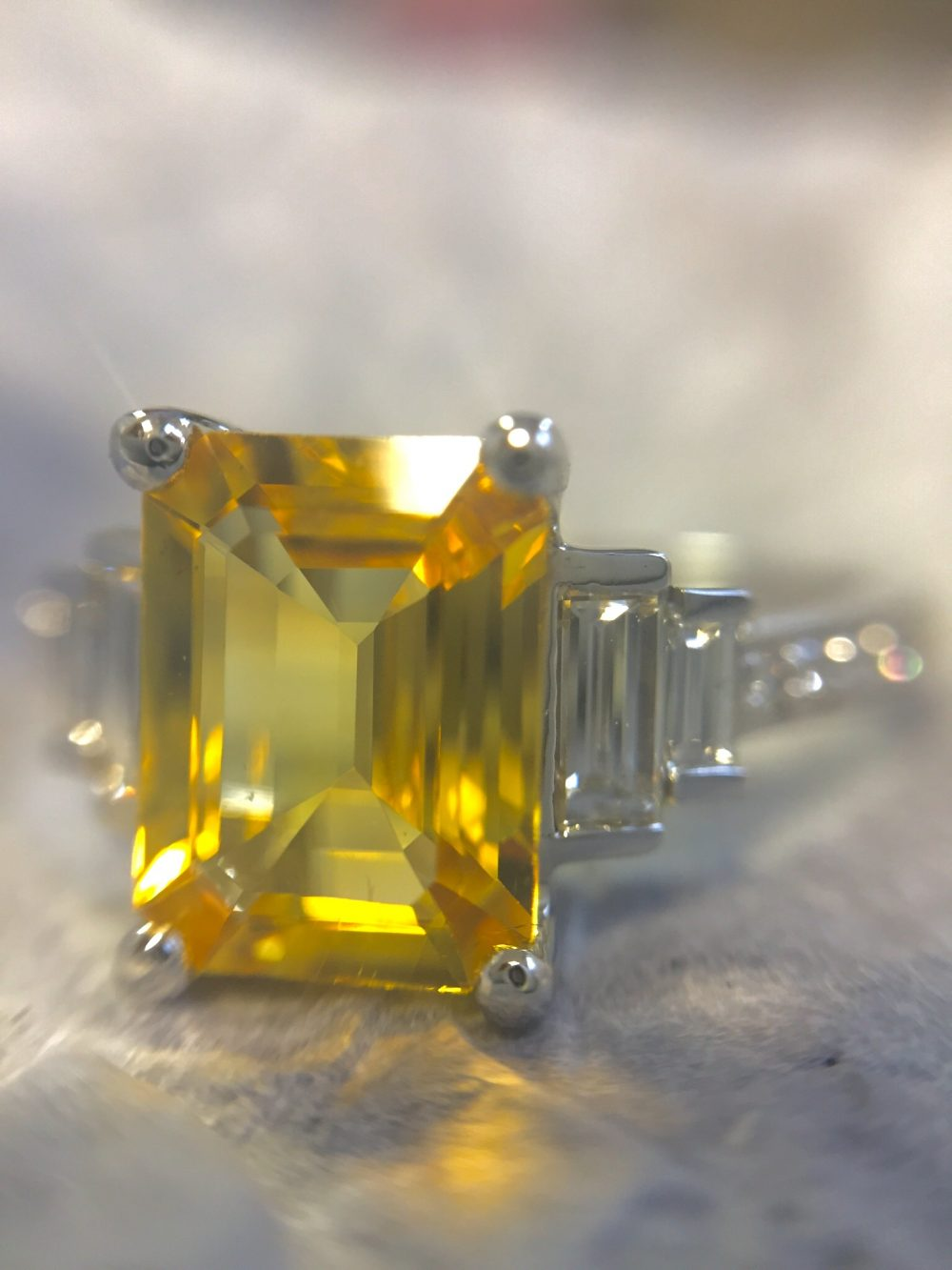 yellow emerald cut sapphire with diamond baguettes engagement ring