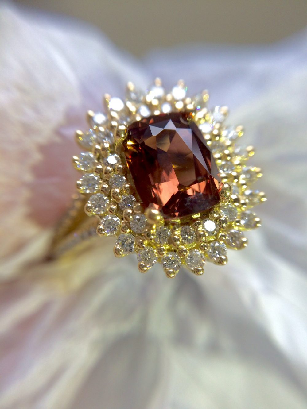 brownish-orange sapphire with double diamond halo yellow gold engagement ring
