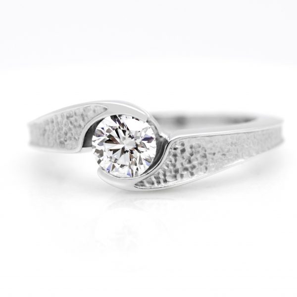 round diamond bypass set pebbled platinum engagement ring