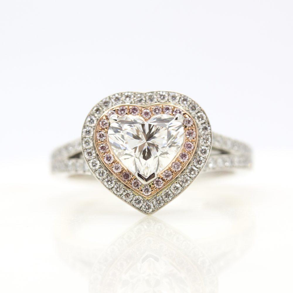 heart diamond with double diamond halo with pink and white diamonds and diamond pave split shank