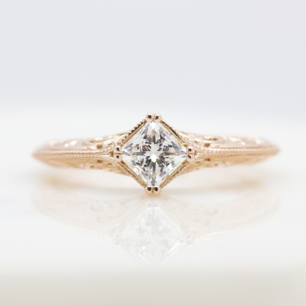 princess cut diamond engagement ring with filigree and milgrain detail