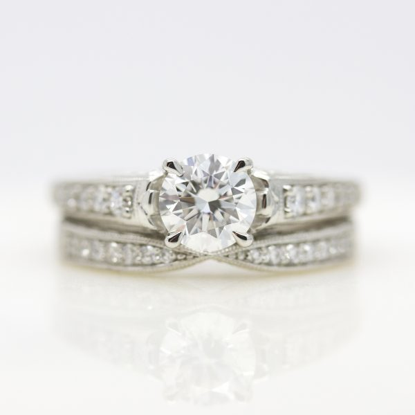 round diamond with bead set diamond band and matching wedding ring