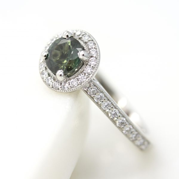 round green sapphire diamond halo engagement ring with milgrain