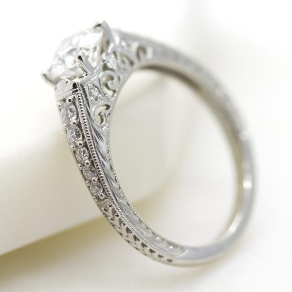 engagement ring with bead-set diamonds, filigree, hand engraving and milgrain