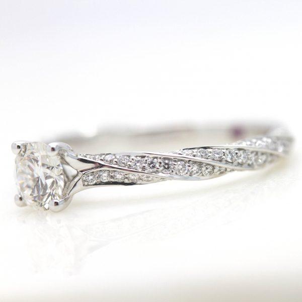 round diamond twisted diamond pave engagement ring