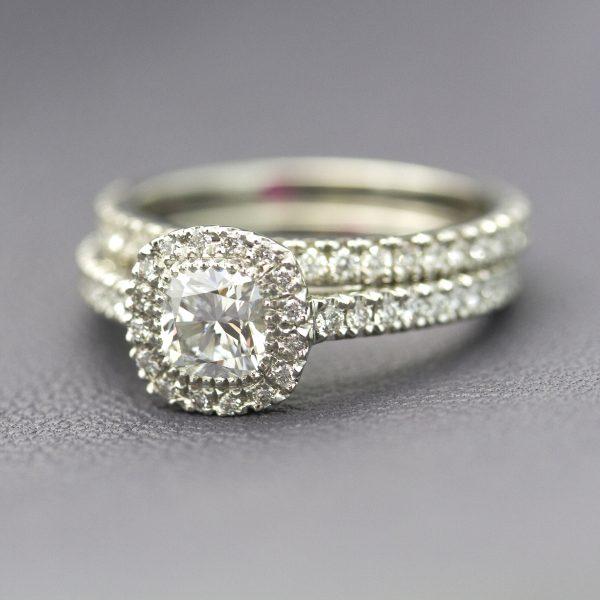 cushion cut diamond halo engagement ring with matching diamond pave wedding band