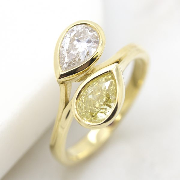 yellow and white pear cut diamonds in a moi et toi yellow gold engagement ring