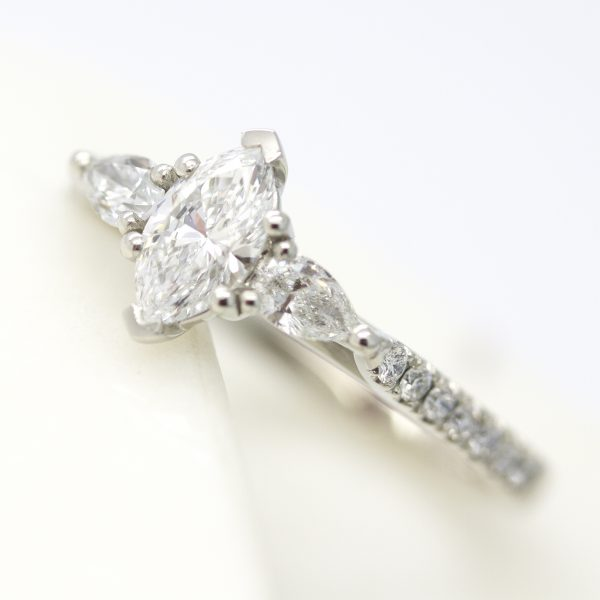 marquise cut diamond with pear accent stones and diamond pave band