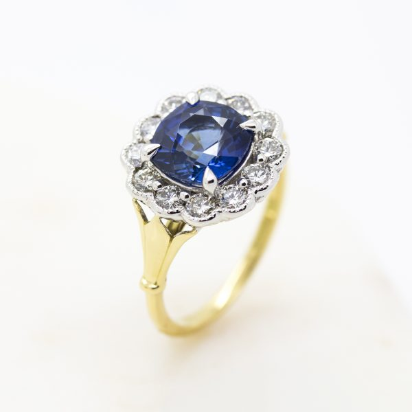 blue cushion cut ceylon sapphire with diamond halo in yellow gold and platinum
