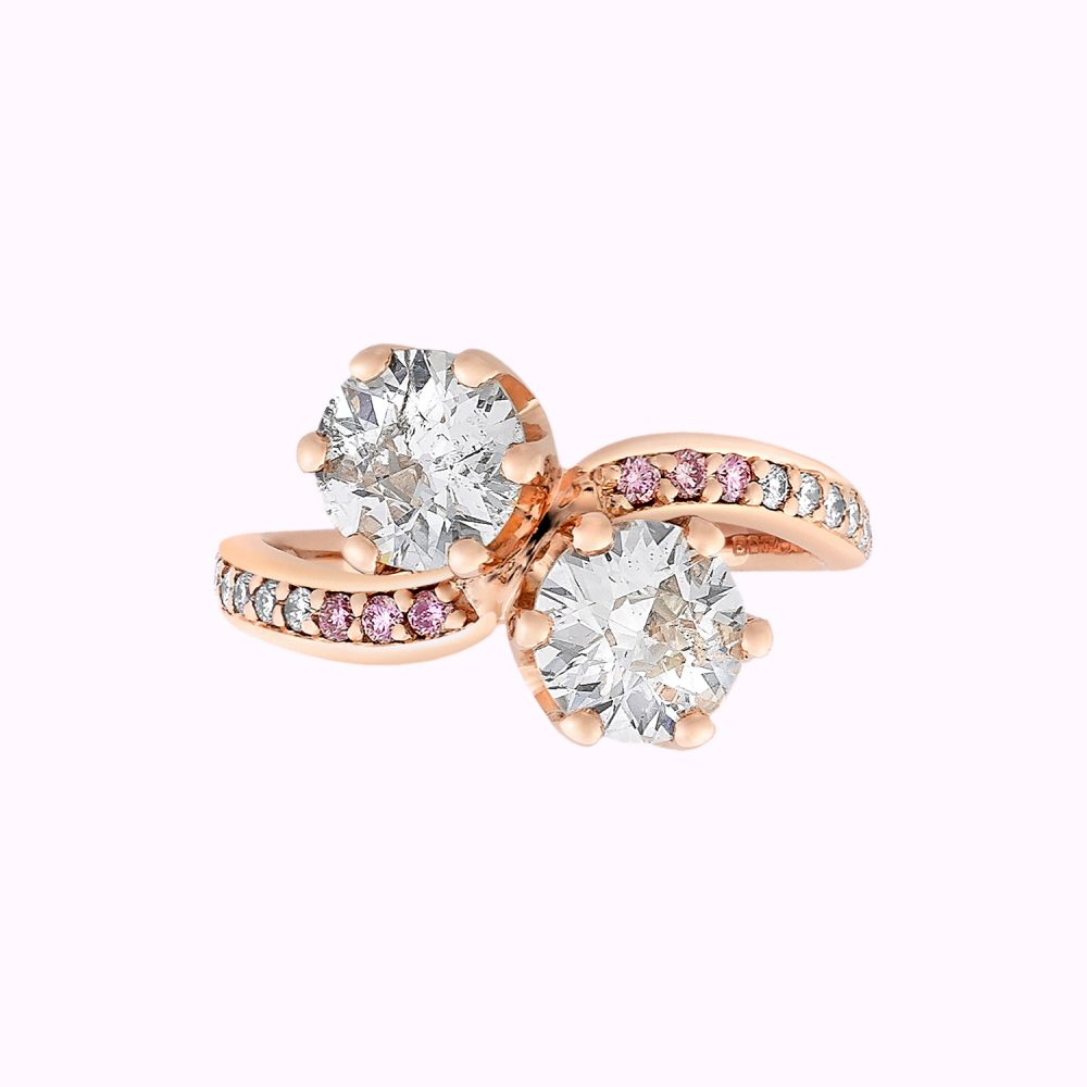rose gold two-stone curved band with pink diamonds and two round white diamonds
