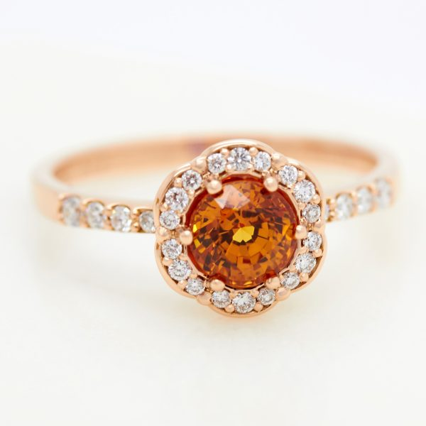 round orange sapphire flower inspired rose gold halo engagement ring