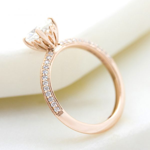 rose gold knife edge engagement ring with milgrain and floral inspired basket