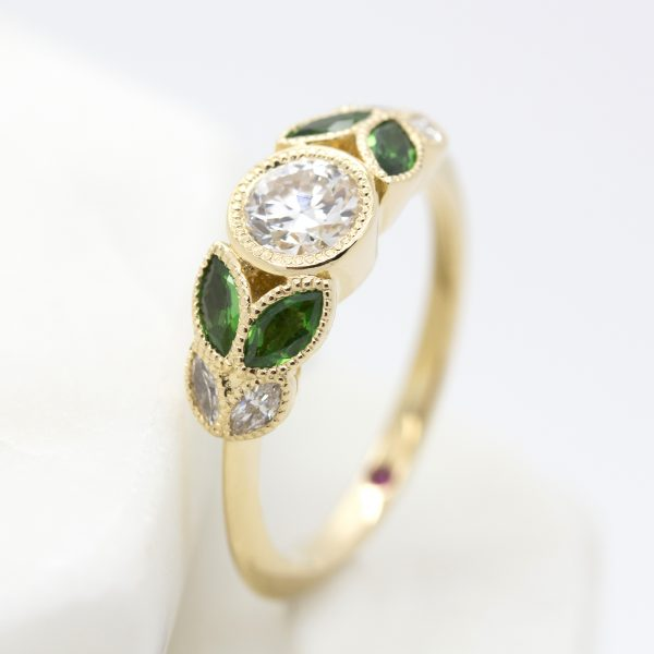 bezel set round diamond with marquise emeralds and diamonds yellow gold organic engagement ring