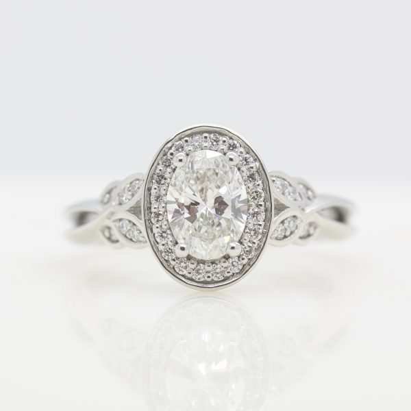 oval diamond with diamond halo and leaf inspired bead set accent diamonds
