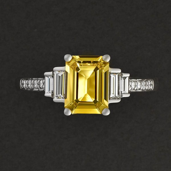 emerald cut yellow sapphire with side baguette diamonds and beat set diamond engagement ring