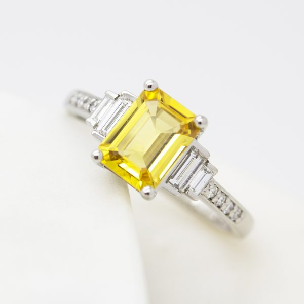 emerald cut yellow sapphire with side baguette diamonds bead set diamond band