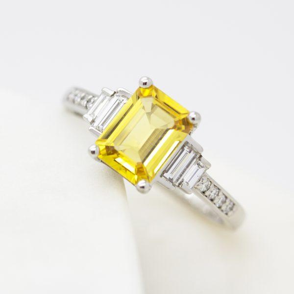 emerald cut yellow sapphire with side baguette diamonds bead set diamond band
