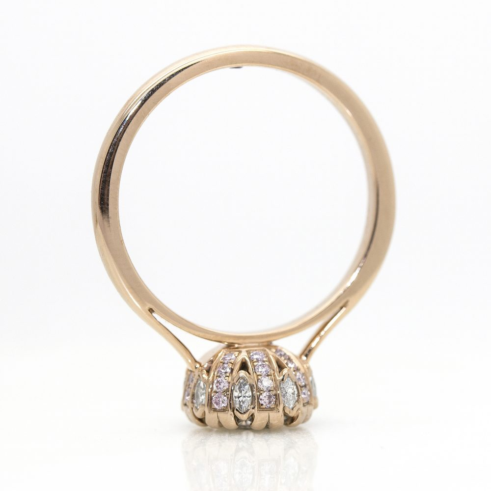 round diamond with pink and white diamonds collet details cathedral setting
