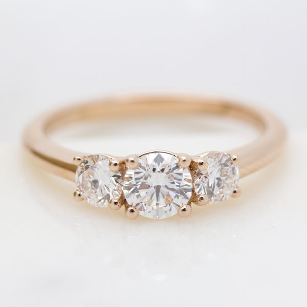 round diamond trilogy engagement ring in rose gold