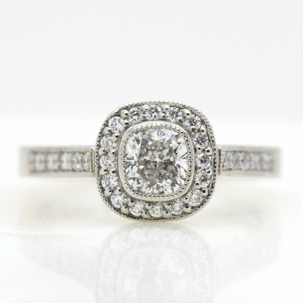 cushion cut diamond with diamond halo and milgrain engagement ring