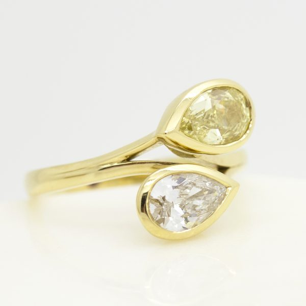 moi et toi engagement ring with yellow and white pear shape diamonds set in yellow gold