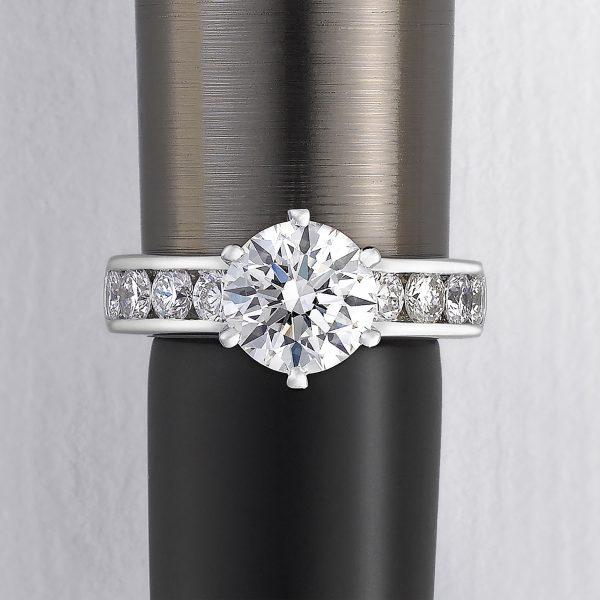 Round center diamond with channel-set diamonds in platinum