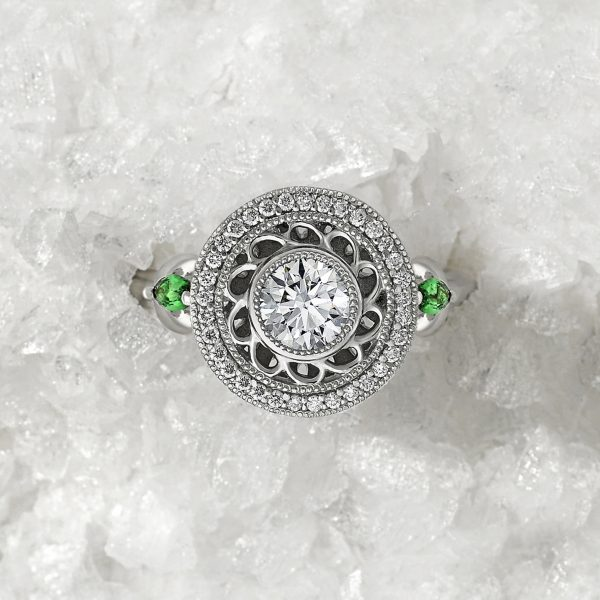 round diamond with filigree detail halo with marquise tsavorites in platinum engagement ring