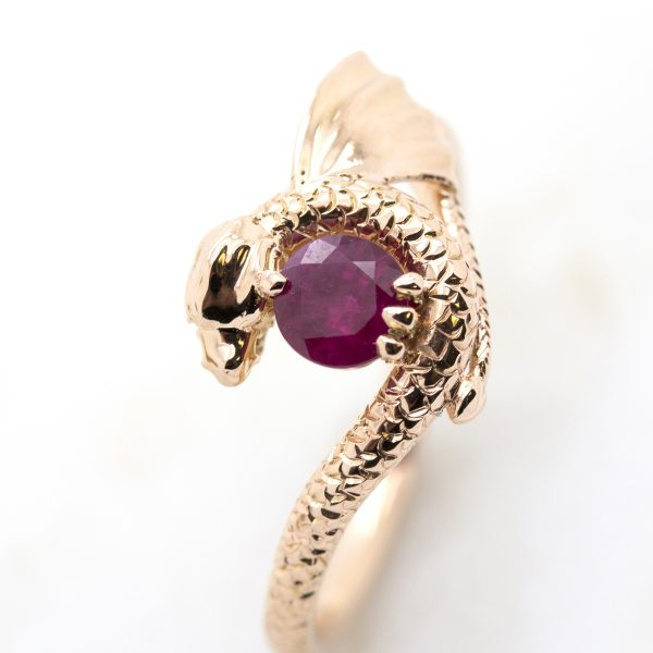 round ruby centre with dragon inspired setting and hand engraving in rose gold
