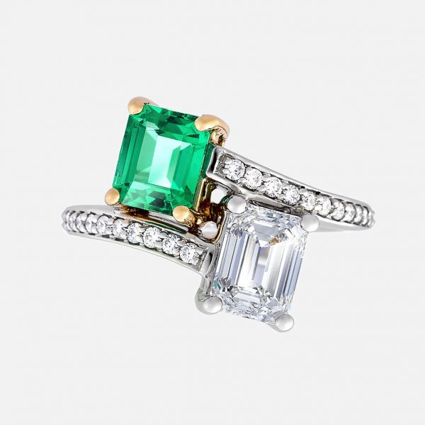 emerald cut emerald and diamond moi et toi ring