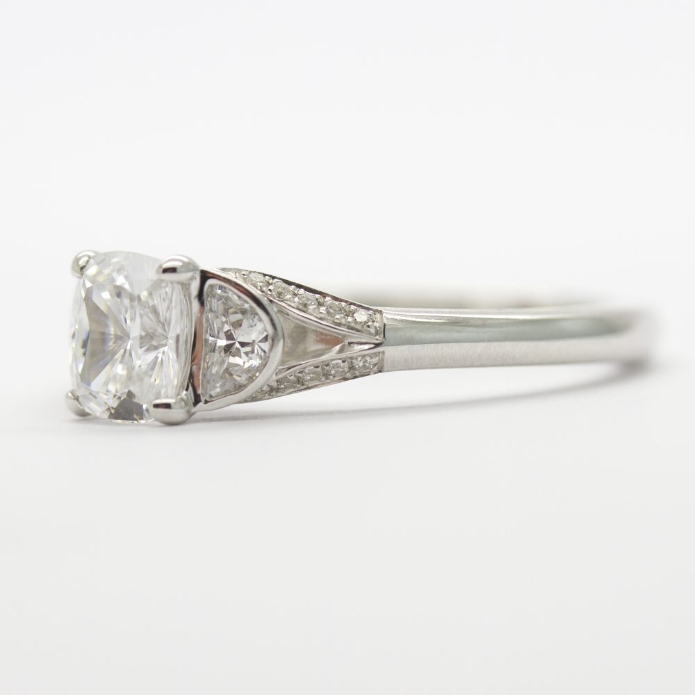 cushion cut diamond with half moon diamond side stones
