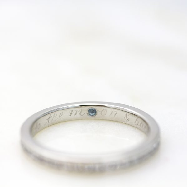 ring with gemstone and hand engraving