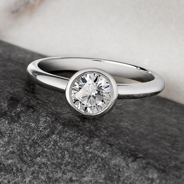 bezel set round diamond engagement ring