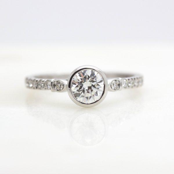 bezel set round diamond with pave diamond engagement ring