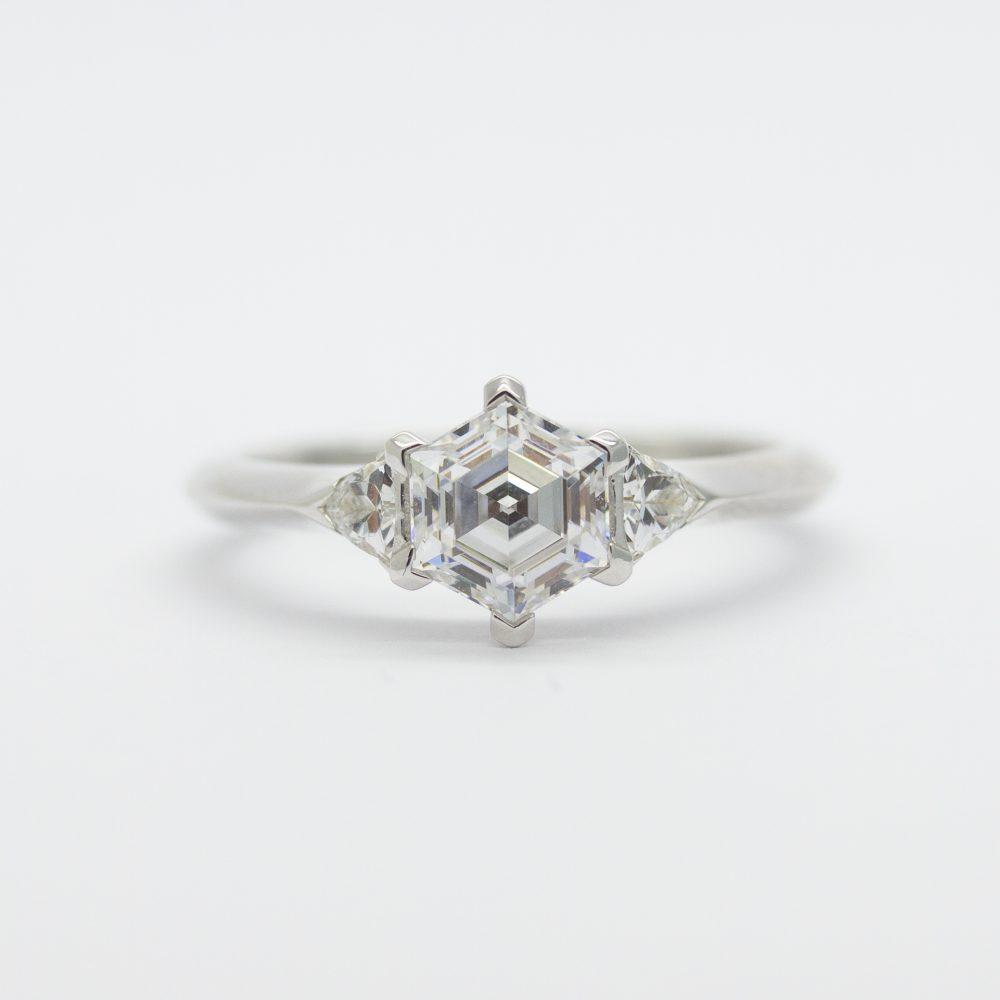 hexagon centre diamond with trilliant side diamonds