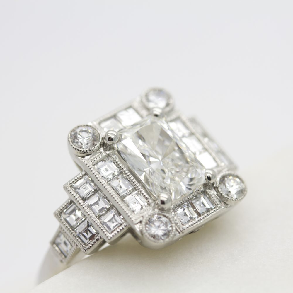 radiant cut diamond with round and carre cut diamond halo