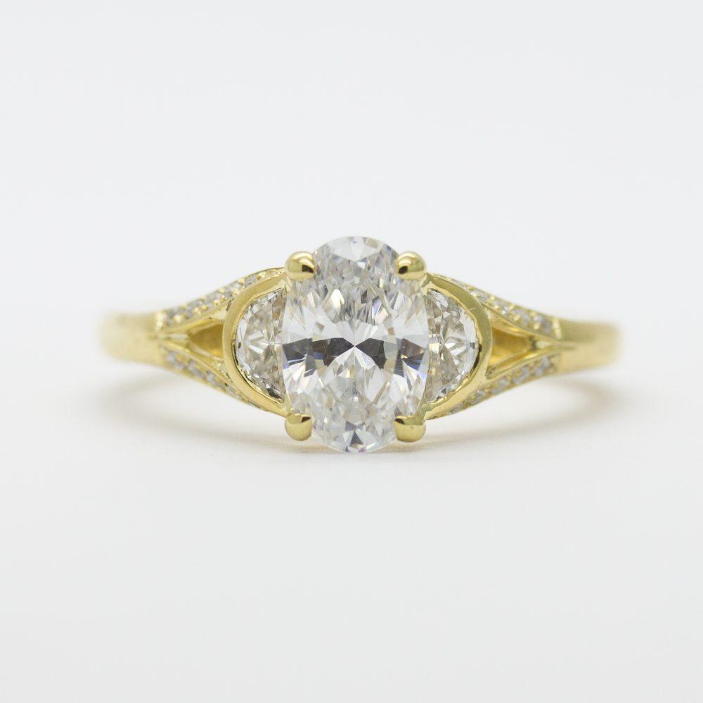 oval diamond with half moon diamond side stones