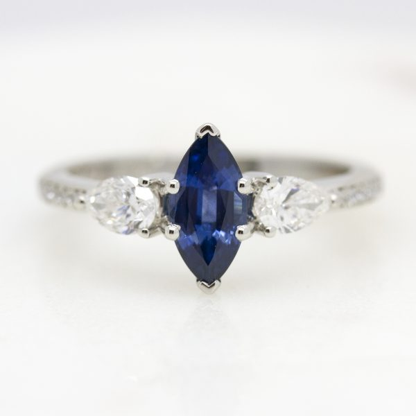 blue sapphire marquise diamond trilogy engagement ring