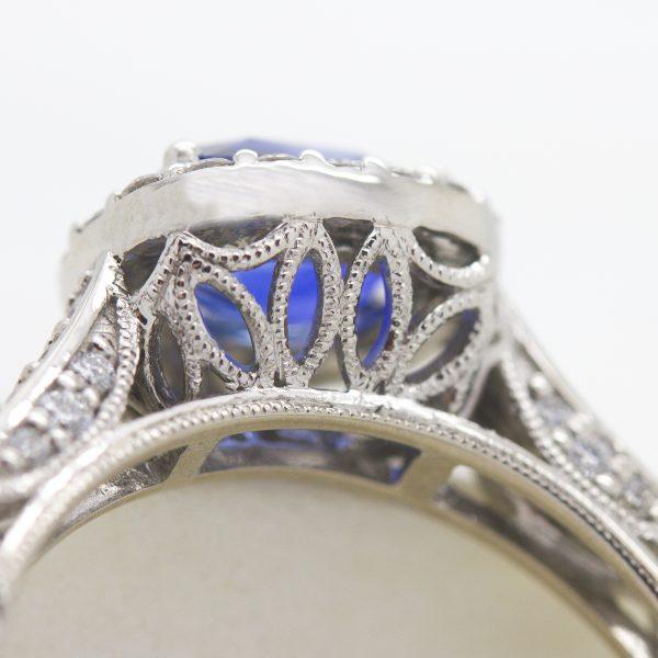 floral petal inspired milgrain collet detail engagement ring