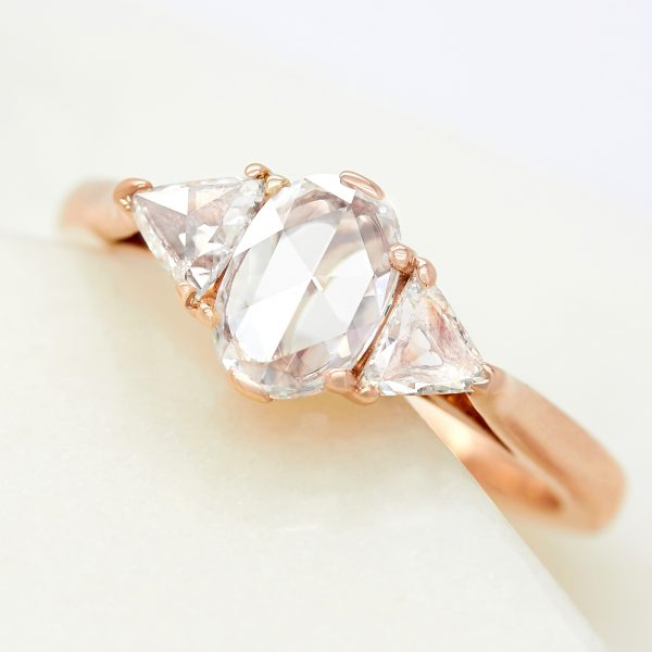 oval rose cut diamond halo trilogy rose gold engagement ring