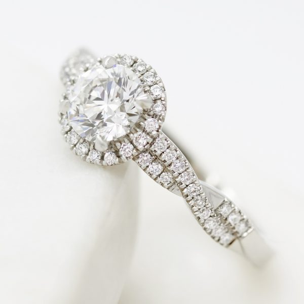 round diamond split twisted pave shank halo engagement ring