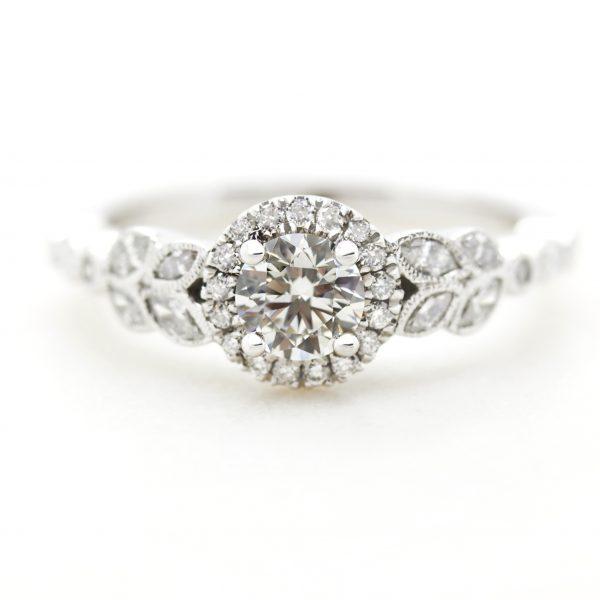 round diamond halo engagement ring with marquise diamond leaf vine milgrain design