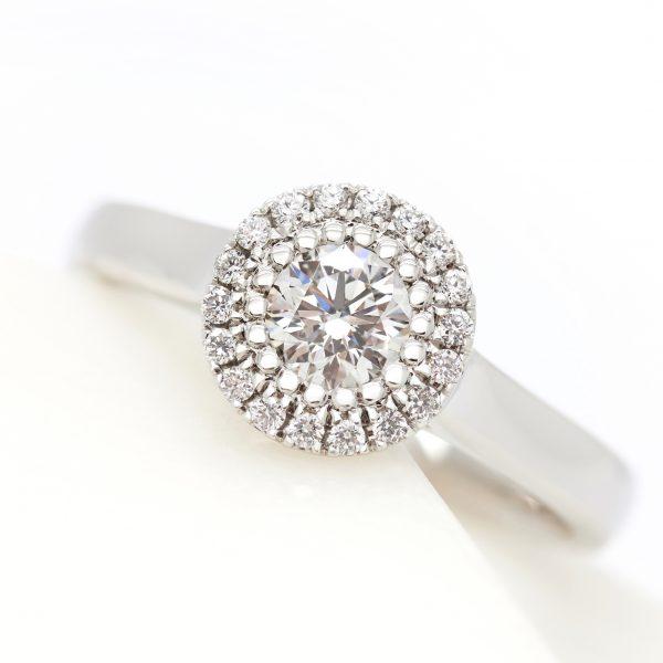 round diamond halo engagement ring with bead setting and plain polished platinum band
