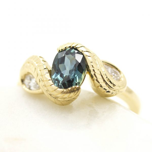 blue green oval sapphire yellow gold organic leaf nature engagement ring design