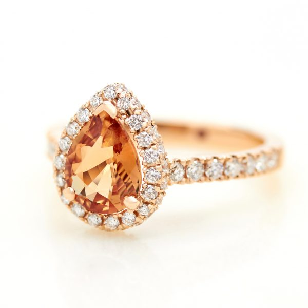 orange pear shape sapphire with diamond halo engagement ring