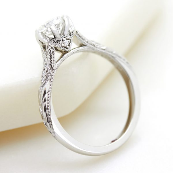platinum engagement ring with surprise setting diamond and milgrain and hand engraving detail