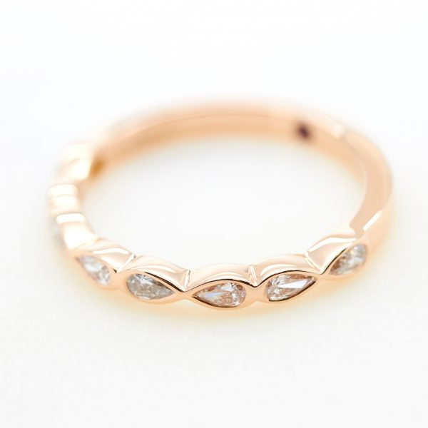 pear shaped diamond bezel set rose gold ladies wedding band