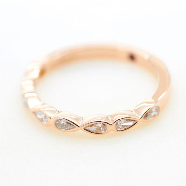 pear shaped diamond bezel set rose gold ladies wedding band