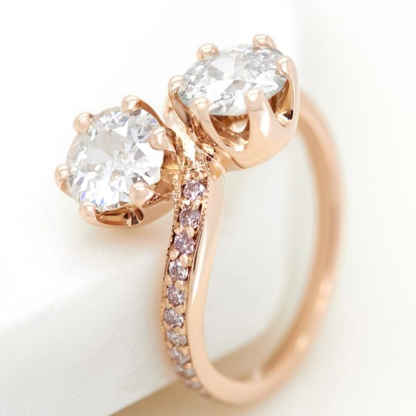 old european diamonds in a crown setting engagement ring with pave pink diamond band